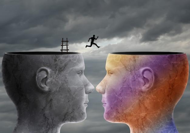 Un uomo salta da una testa all'altra