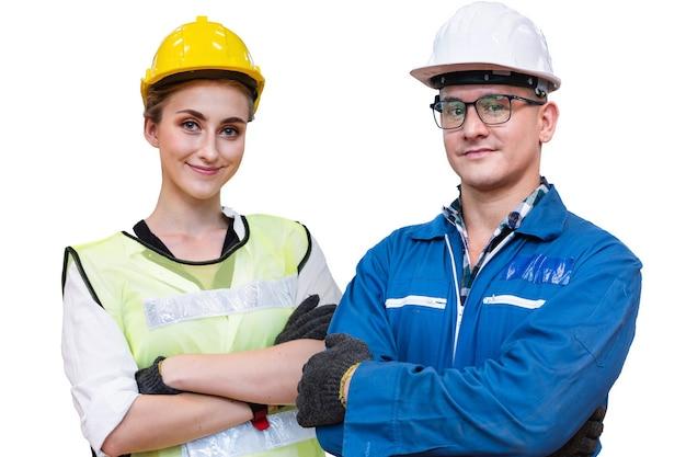 La gente manuale di donna e uomo lavoratore è in piedi con sicurezza con il vestito blu da lavoro