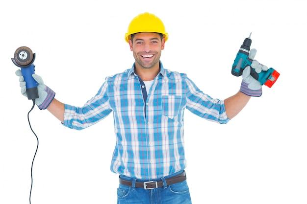 Utensili elettrici della tenuta dell'operaio manuale