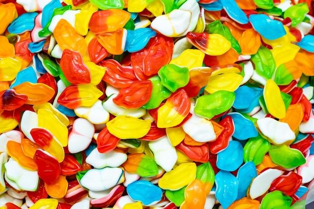 Molte caramelle colorate luminose, sfondo