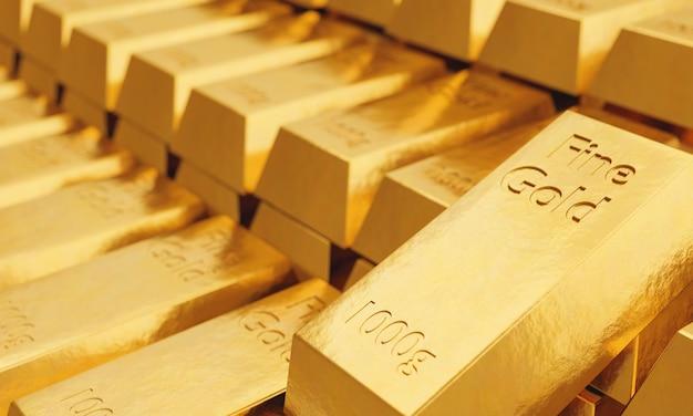 Molti lingotti d'oro fino del peso di 1 kg con superficie sfocata