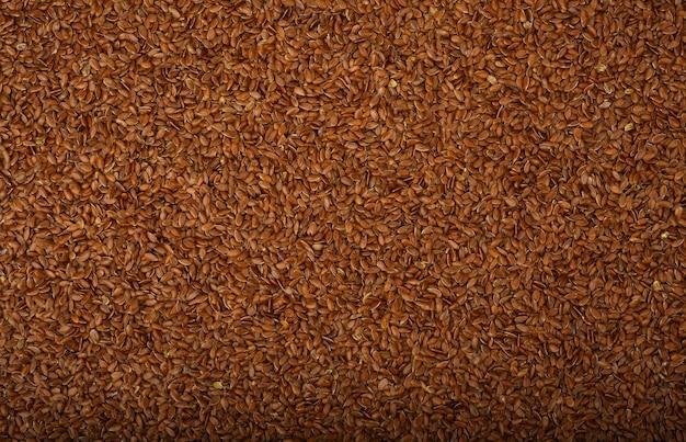 Molti semi di lino come sfondo