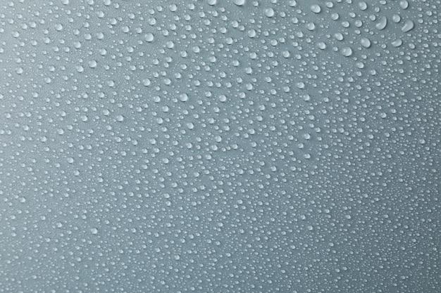 Molte gocce d'acqua su grigio. trama, da vicino