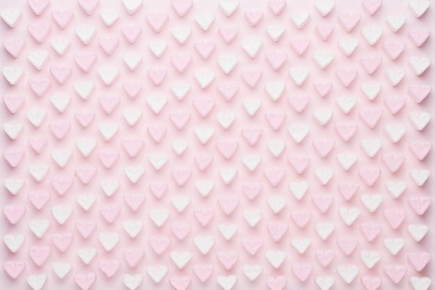 Marshmallow su sfondo rosa con copyspace