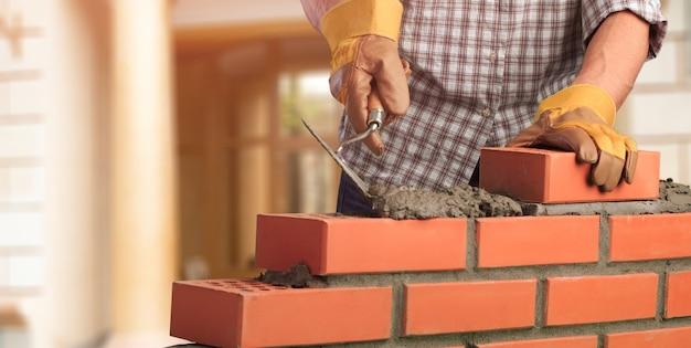 Muratore costruzione muratore costruzione tuttofare strato cazzuola