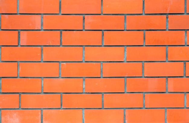 Muratura o nuovo muro di mattoni pulito. struttura e modello di una parete di pietra del mattone