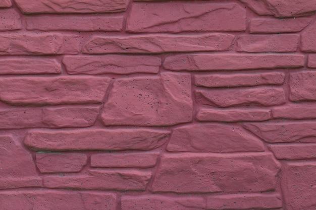 Muro in muratura di pietra rossa