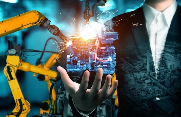 Braccio robot industriale meccanizzato e doppia esposizione operaio di fabbrica Foto Premium