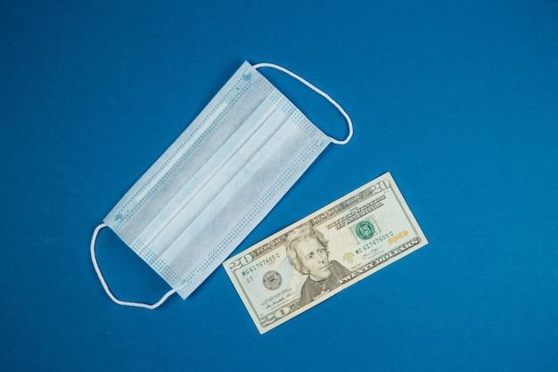 Maschera medica e denaro, epidemia di coronavirus mondiale e danni economici.