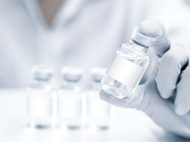 Fiale di vaccino medico con etichetta vuota bianca in mano dello scienziato con guanti di gomma bianca. chiuda sull'immagine della mano che tiene le bottiglie di vetro del vaccino per l'iniezione.