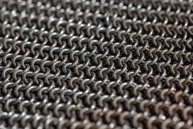 Cotta di maglia medievale, anelli di ferro intrecciati collegati tra loro