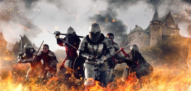 Cavalieri medievali in armatura ed elmi con spade e asce sul campo di battaglia, grande combattimento. antichi guerrieri corazzati contro il castello
