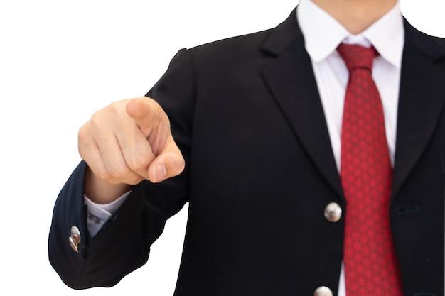 Corpo dell'uomo di affari del colpo medio in vestito nero con il punto del dito della mano sullo spazio