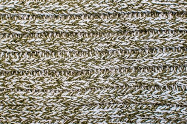 Maglione o sciarpa di filo intrecciato melange come sfondo.