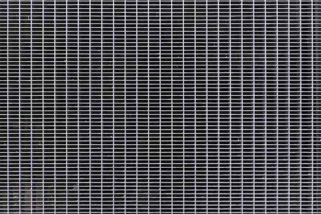 Struttura delle griglie del pavimento del metallo. modello astratto in metallo argento.