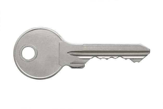 Chiavi dell'appartamento lucide del metallo isolate su fondo bianco, chiave piana