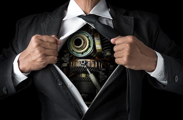 Macchinari metallici all'interno del corpo dell'uomo d'affari nel concetto di laboriosa