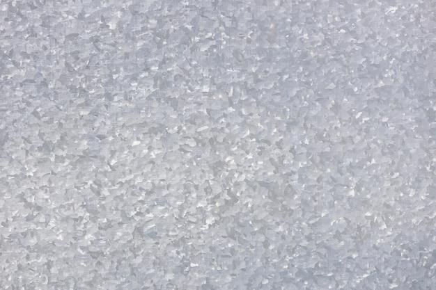 Piatto di metallo. muro d'argento di ferro. trama maculata. foto di alta qualità