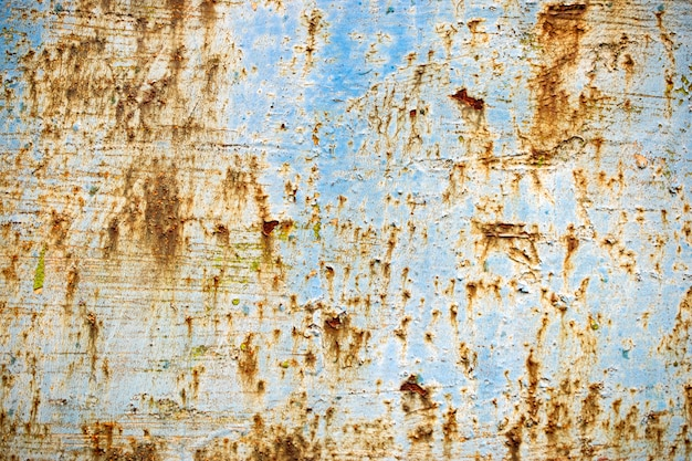 Struttura del metallo con vernice blu e ruggine.