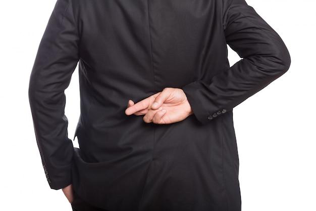 Metà di sezione di un uomo d'affari con le dita incrociate