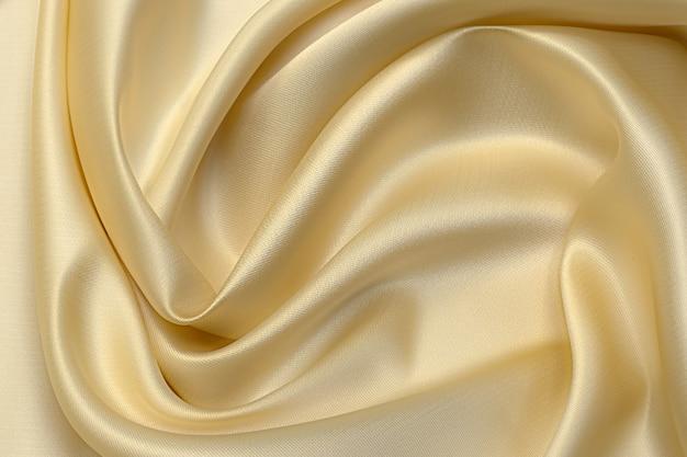Disposizione artistica in tessuto di seta taffetà color latte. trama, sfondo. modello.