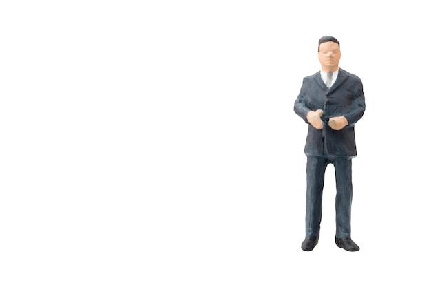 Uomo d'affari miniatura della gente su fondo bianco