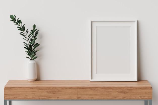 Interior design minimale con cornice mockup un vaso per piante su tavolo in legno con rendering 3d a parete bianca