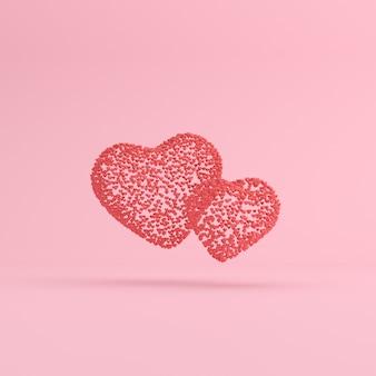 Scena minimale di piccoli cuori galleggianti a forma di cuore