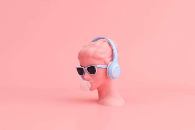 Scena minima di occhiali da sole e cuffie sulla scultura della testa umana, concetto di musica.