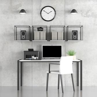 Area di lavoro domestica minimalista con laptop e stampante sulla scrivania