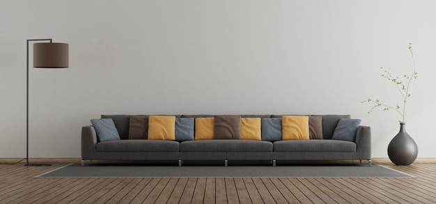 Soggiorno minimalista con ampio divano