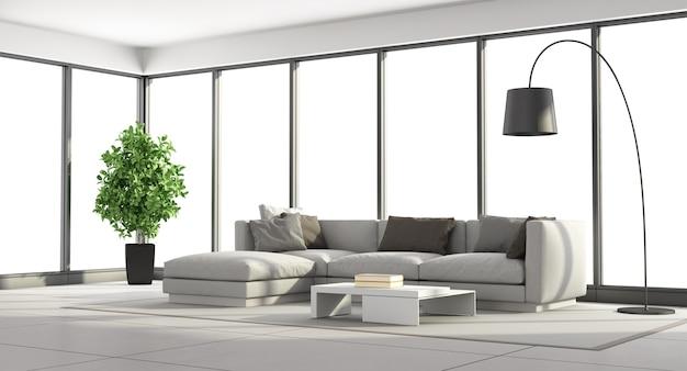 Soggiorno minimalista con divano e ampie finestre