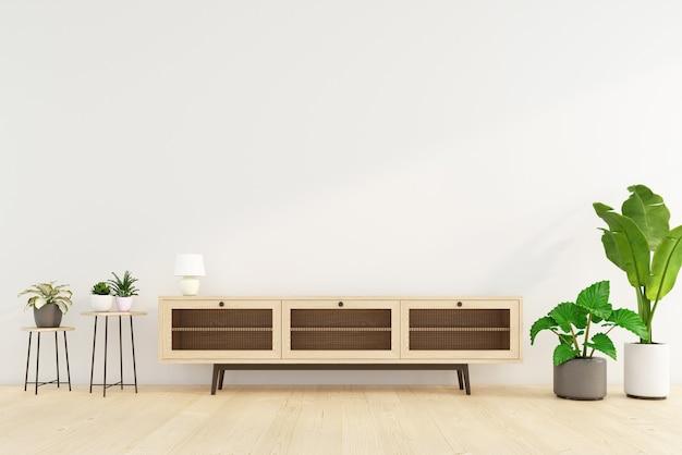 Soggiorno minimalista con mobile tv e tavolino, parete bianca e pianta verde. rendering 3d