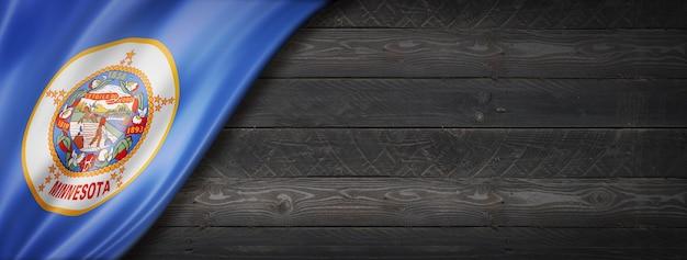 Bandiera del minnesota sul banner di parete in legno nero, stati uniti d'america. illustrazione 3d