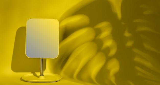 Specchio su una parete gialla con copia spazio