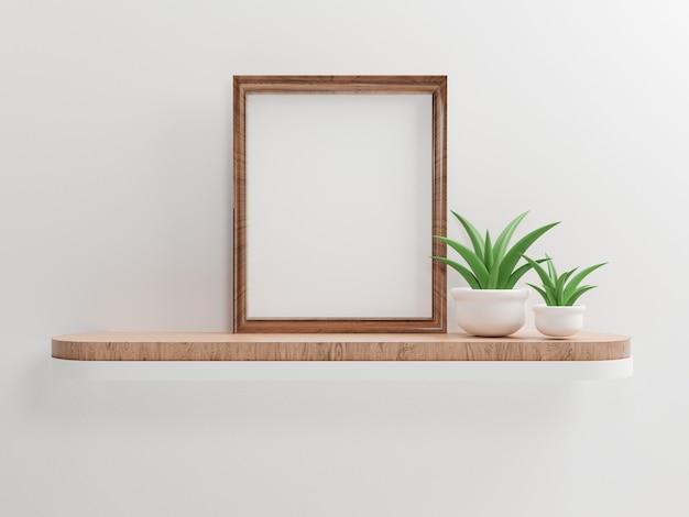 Mock up cornice per foto in legno con pianta verde all'interno del vaso sullo scaffale e sullo sfondo della parete bianca, rendering 3d.