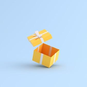 Manichino del contenitore di regalo giallo su spazio blu.