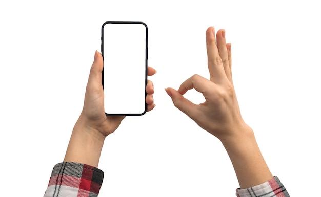 Mockup telefono cellulare e gesto ok isolato su uno sfondo bianco, concetto di recensioni e valutazioni dei clienti, isolato su una foto di sfondo bianco
