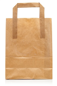 Mockup di sacchetto di carta con posto per logo isolato su priorità bassa bianca