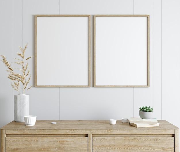 Mockup poster frame in interni moderni con parete bianca e console in legno, interni domestici con piante, rendering 3d