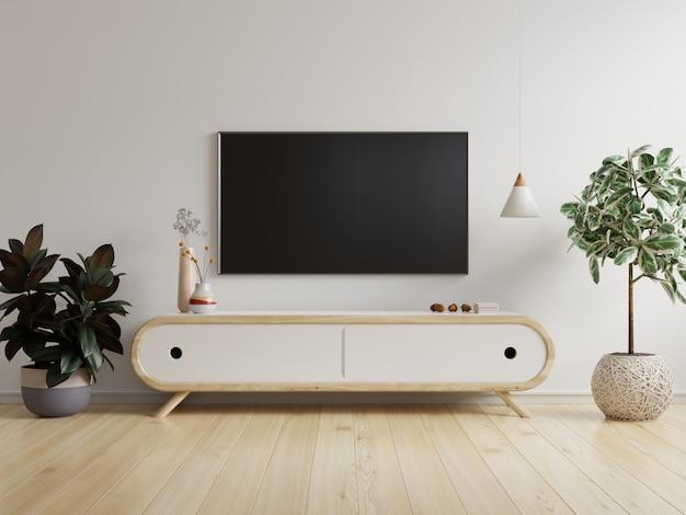 Mockup di una tv montata a parete in un soggiorno con una parete bianca. rendering 3d Foto Premium