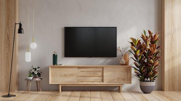 Mockup di una tv montata a parete in un soggiorno con mobile in legno. rendering 3d