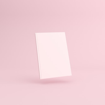 Mockup del libro bianco bianco sul rosa