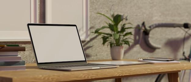 Posto di lavoro moderno dell'appartamento con il computer portatile nel modello in bianco dello schermo sul worktable di legno 3d