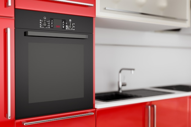 Forno elettrico nero moderno costruito in primo piano estremo di mobili da cucina rossi. rendering 3d