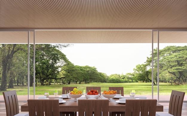 Moderna sala da pranzo contemporanea 3d rende ci sono grandi porte aperte che si affacciano sulla terrazza e sul giardino