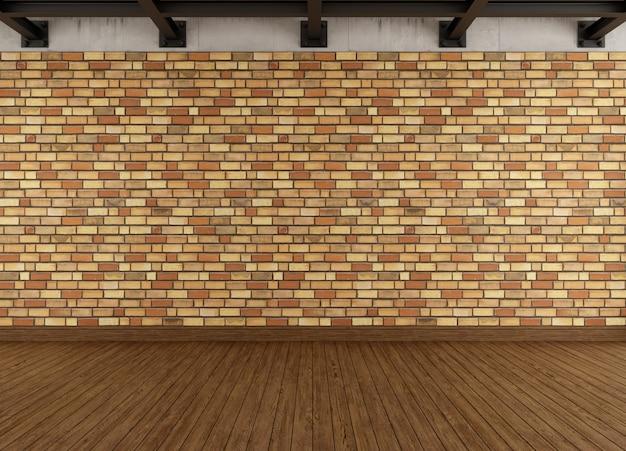 Interiore moderno del grunge con il muro di mattoni