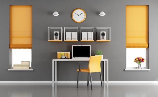 Area di lavoro domestica moderna con laptop sulla piccola scrivania