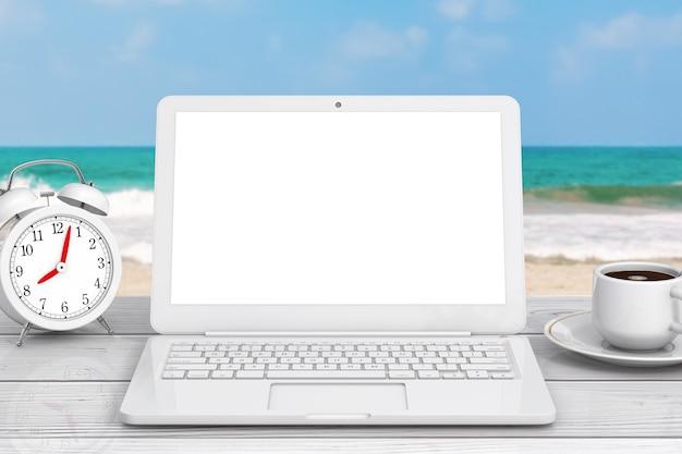 Computer portatile moderno, tazza di caffè e sveglia davanti al primo piano estremo dell'oceano. rendering 3d