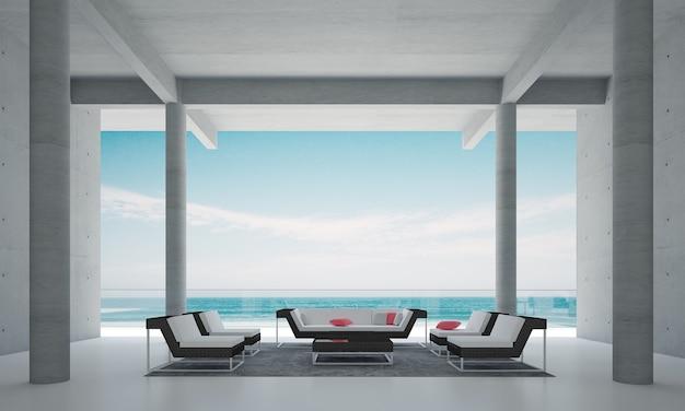 Il soggiorno moderno e la decorazione dei mobili simulati e lo sfondo del muro di cemento e la vista sul mare